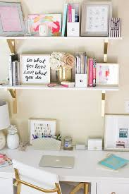 a cute but not too organised casual look with basic white and gold themes some cute cute desk decordesk