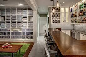and bar built in coffee table counter stools glass tile green area rug hobby home bar pendant lights shelves tile floor wall storage wine cellar wood