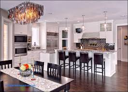 an impressing black chandelier for modern kitchen with white cabinetry and marble countertop also black brick