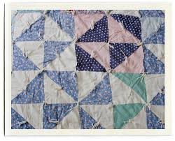 inchmark - inchmark journal - sweet dreams & I'm a fan of white in quilts, and lots of it. This quilt has a mainly white  ground, but then random squares of blue, and pink, even black. Adamdwight.com