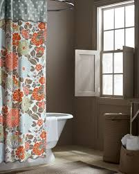 coral and brown shower curtain. coral garden bathroom, from garnet hill, bathroom shutters. all soft colors.except shower curtain. and brown curtain l