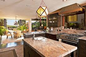 Tropical Kitchen with Hawaiian Bordeaux Granite Countertop, Pendant Light,  Custom hood, Kitchen island