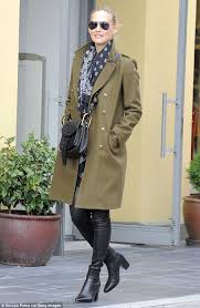 under wraps bar refaeli kept her toned physique well wrapped in a smart military green