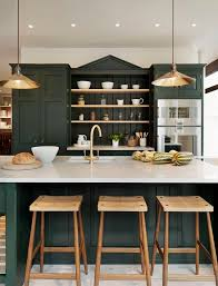 green paint colors for kitchen cabinets. hunter green kitchen cabinets with a brass sink faucet, pendant lights and hardware atop carrera paint colors for h