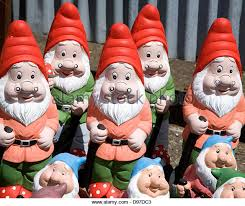 colourful garden gnomes lined up for uk stock image