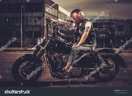 biker his bobber style motorcycle on stock photo 273101117