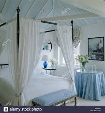 Small Bedroom Stool Simple Four Poster Bed With White Drapes In White Bedroom With
