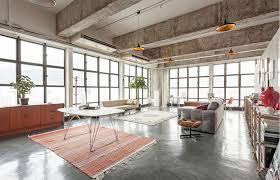 View in gallery Large living space with industrial-style windows and Tom  Dixon pendant lights