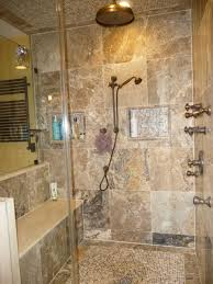 interior shower room with black metal shower on brown wall tile connected by square shelf