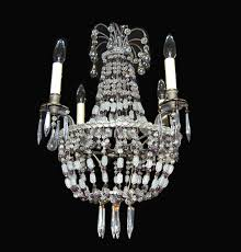 a dainty vintage french crystal basket form chandelier from around the beginning of the 20th century having a metal frame adorned with clear crystal and