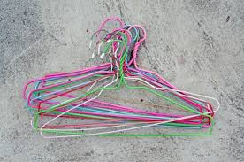 Pile of wire hangers on cement background