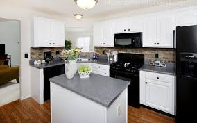 Small Picture Kitchen White Galley Kitchen With Black Appliances Wainscoting