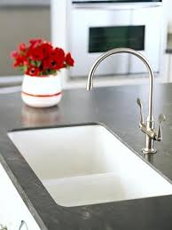black kitchen corian countertops used for the sink area
