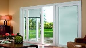 with top sliding doors with blinds between sliding patio