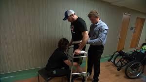 a paraplegic man patient learns to walk again