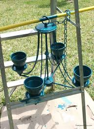 repurposed chandelier into hanging flower pot with spray paint