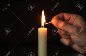 hand lighting. Hand With Lighting Match And Candle Standing On Dark Background Stock Photo - 3536776 D