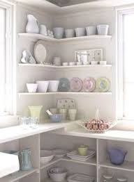 This open corner shelf adds flair to what would have been an awkward .