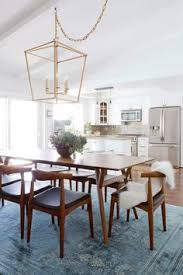tour a home with mid century bones and a healthy dose of glam mid century modern dining roommodern