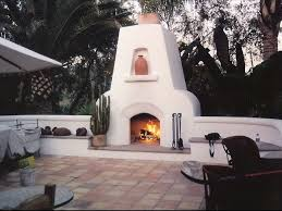 custom masonry stucco outdoor chimney and rumford style fireplace