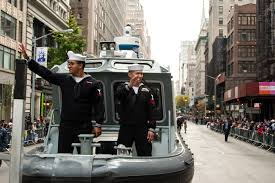 u s department of defense photo essay sailors wave to crowds along the fifth avenue parade route from the bed of a harbor