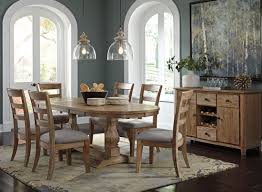 Danimore Light Brown Extendable Oval Dining Room Set From Ashley - Formal oval dining room sets