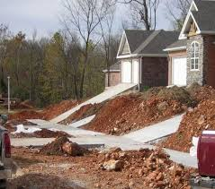 skip retaining wall for steep driveway