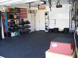 awesome garage gym photo with a jump box kettle bells and dumbells on rack garage gym ideas r28