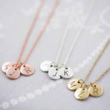left to right rose gold silver gold rose gold gold triple letter disc necklace