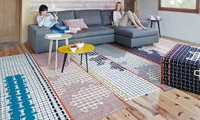 the modular bandas rugs are the design of patricia urquiola for gan designed to be completely interchangeable the large stitch pattern on the runners