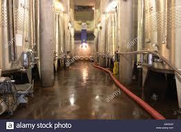 El iva hall con tanques de fermentación de acero inoxidable y símbolos  solares. Chateau Romanin, Saint Remy de Provence, Bouches du Rhône,  Provence, Francia, Europa Fotografía de stock - Alamy
