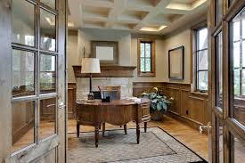 this gorgeous office is an example of a home office i would love to have with the hardwood floor area rug fireplace floor to ceiling shelves and a piano