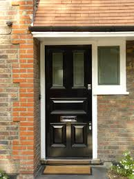 clean lines and shiny black paint on this front door by the london door company