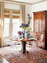 dining room by meg lonergan oriental rug lucite chairs perfect balance of old and new