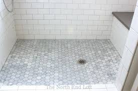 how to grout shower tile the shower floor is hexagon shaped marble tiles with darker gray how to grout shower tile