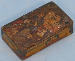 a 19th century papier mache snuff box decorated with eastern figures and landscape hinged lid enclosing further decoration of figure on horseback