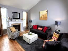 Yellow Black And Red Living Room Living Room Yellow Cushions Black Curtain Hardwood Flooring