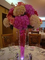 hanging crystals for wedding centerpieces. elevated centerpiece with hydrangeas and roses hanging crystal accent colored water in vase crystals for wedding centerpieces e