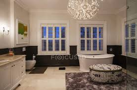 soaking tub and modern chandelier in luxury bathroom at night home interior interior design stock photo 199363108