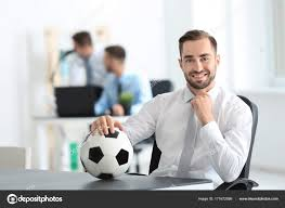 Young Handsome Man With Soccer Ball In Office Stock Photo
