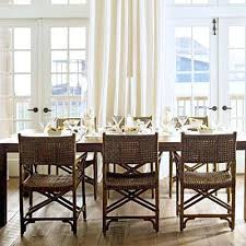 rattan dining room set. wicker dining chairs room with brown mesh backing surround a table . rattan set