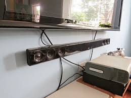He also has a game console but there was no issue with that. But also, our  cable outlet is above the shelf, the power outlet below.