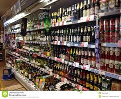 Alcohol Cabinet Bottles Of Alcohol In A Display Cabinet Editorial Stock Image