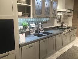 grey kitchen cabinets with stained glass doors