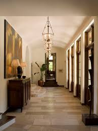 example of a classic travertine floor hallway design in austin with white walls