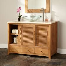 unfinished wooden vanity with sliding door and drawers decor with glass vessel sink modern bathroom