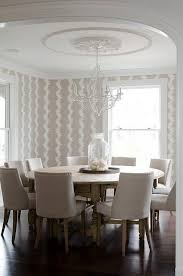 beige dining room with round dining table seats 10
