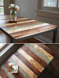 Vintage old rulers and yardsticks into a wooden table top; upcycle,  recycle, salvage