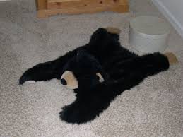 small black faux bearskin rug with head the most popular faux bear skin rug ideas