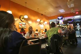 mexican restaurant people. Simple Mexican Watching TV In Restaurant On Mexican Restaurant People A